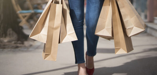 Unrecognizable woman carrying a lot of shopping bags.